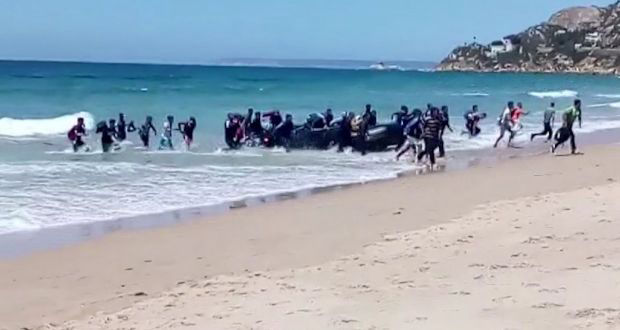 Migrants storm beach Cadiz Spain